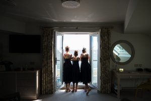 bridesmaids looking out of window
