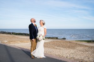 bride and groom at seafront