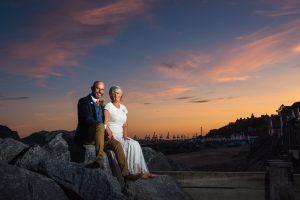 bride and groom at sunset on felixstowe beach