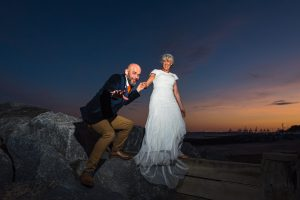 bride and groom at sunset felixstowe seafront