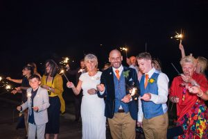 brde and groom with sparklers at felixstowe